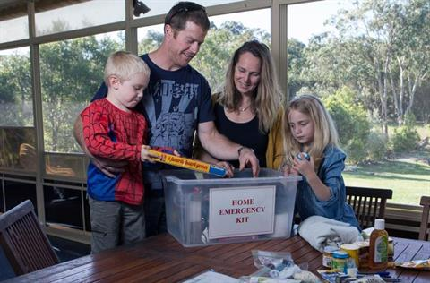 Family making emergency kit and plan - Be Ready Be Safe - 2013 - 6.JPG